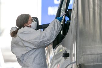 MATREI AM BRENNER, AUSTRIA - MARCH 11: A woman in protective gear  checks the temperature of passengers in cars arriving from Italy at the Brenner Pass border crossing on March 11, 2020 near Matrei am Brenner, Austria. Austrian Chancellor Sebastian Kurz yesterday announced Austria is turning away people arriving from Italy, except those with a doctor's certificate, in a measure to prevent the spread of the coronavirus. Freight is still being allowed in and any Austrians arriving will also be admitted but will need to submit to quarantine. The Italian government yesterday imposed nationwide measures in a bid to slow the spread of the virus, which has topped 9,100 confirmed cases in Italy. (Photo by Jan Hetfleisch/Getty Images)