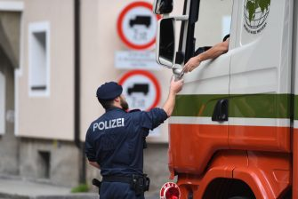 GRIES AM BRENNER, AUSTRIA - JULY 11: An Austrian police officer checks a truck at a checkpoint at the border between Austria and Italy prior to the European Union member states' interior and justice ministers conference on July 11, 2018 in Innsbruck, Austria. The meeting is taking place among mounting efforts by governments across Europe to restrict the entry of migrants and refugees. (Photo by Andreas Gebert/Getty Images)