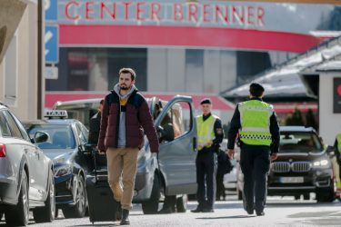 MATREI AM BRENNER, AUSTRIA - MARCH 11: A man from Germany crosses the border between Austria and Italy after arriving at the Brenner Pass near Matrei am Brenner on March 11, 2020 near Matrei am Brenner, Austria. Austrian Chancellor Sebastian Kurz yesterday announced Austria is turning away people arriving from Italy, except those with a doctor's certificate, in a measure to prevent the spread of the coronavirus. Freight is still being allowed in and any Austrians arriving will also be admitted but will need to submit to quarantine. The Italian government yesterday imposed nationwide measures in a bid to slow the spread of the virus, which has topped 9,100 confirmed cases in Italy. (Photo by Jan Hetfleisch/Getty Images)