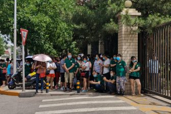BEIJING, CHINA - JUNE 16: (EDITOR'S NOTE: Photo taken with mobile phone camera.) Citizens who visited or live near Xinfadi Market queue for a nucleic acid test at a sports center on June 16, 2020 in Beijing, China. From June 11 to June 16, Beijing reported a total of 106 new confirmed cases of coronavirus (covid-19), the number of new infection has risen after no new cases for nearly two months. (Photo by Lintao Zhang/Getty Images)