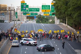 epa08487495 Protesters shut down Interstate 395, a highway that runs through the nation's capital, during a protest to demand justice for George Floyd and for racial equality, in Washington, DC, USA, 15 June 2020. Protesters kneeled on the ground and forced traffic to stop. The death of George Floyd while in police custody in Minneapolis has sparked global protests demanding policing reform.  EPA/MICHAEL REYNOLDS