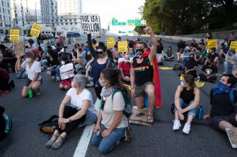 epa08487483 Protesters shut down Interstate 395, a highway that runs through the nation's capital, during a protest to demand justice for George Floyd and for racial equality, in Washington, DC, USA, 15 June 2020. Protesters kneeled on the ground and forced traffic to stop. The death of George Floyd while in police custody in Minneapolis has sparked global protests demanding policing reform.  EPA/MICHAEL REYNOLDS