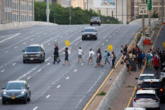 epa08487485 Protesters shut down Interstate 395, a highway that runs through the nation's capital, during a protest to demand justice for George Floyd and for racial equality, in Washington, DC, USA, 15 June 2020. Protesters kneeled on the ground and forced traffic to stop. The death of George Floyd while in police custody in Minneapolis has sparked global protests demanding policing reform.  EPA/MICHAEL REYNOLDS