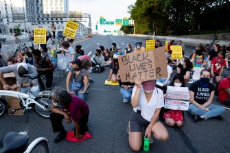 epa08487486 Protesters shut down Interstate 395, a highway that runs through the nation's capital, during a protest to demand justice for George Floyd and for racial equality, in Washington, DC, USA, 15 June 2020. Protesters kneeled on the ground and forced traffic to stop. The death of George Floyd while in police custody in Minneapolis has sparked global protests demanding policing reform.  EPA/MICHAEL REYNOLDS