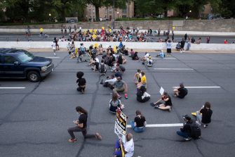 epa08487489 Protesters shut down Interstate 395, a highway that runs through the nation's capital, during a protest to demand justice for George Floyd and for racial equality, in Washington, DC, USA, 15 June 2020. Protesters kneeled on the ground and forced traffic to stop. The death of George Floyd while in police custody in Minneapolis has sparked global protests demanding policing reform.  EPA/MICHAEL REYNOLDS