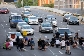 epa08487487 Protesters shut down Interstate 395, a highway that runs through the nation's capital, during a protest to demand justice for George Floyd and for racial equality, in Washington, DC, USA, 15 June 2020. Protesters kneeled on the ground and forced traffic to stop. The death of George Floyd while in police custody in Minneapolis has sparked global protests demanding policing reform.  EPA/MICHAEL REYNOLDS