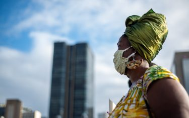 RIO DE JANEIRO, BRAZIL - JUNE 16: A demonstrator wearing a face mask looks on during a protest amidst the coronavirus (COVID-19) pandemic at Praca XV on June 16, 2020 in Rio de Janeiro, Brazil. (Photo by Ide Gomes/Getty Images)