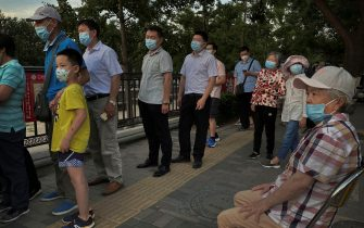 BEIJING, CHINA - JUNE 16:(eds note: photo taken with mobile phone) People who have had contact with the Xinfadi Wholesale Market or someone who has, line up for a nucleic acid test for COVID-19 at a testing center on June 16, 2020 in Beijing, China. Authorities are trying to contain the outbreak linked to the Xinfadi wholesale food market, Beijing's biggest supplier of produce and meat. Several neighborhoods have been locked down and at least two other food markets were closed, as tens of thousands of people are being urged to get tested for COVID-19 at sites set up around the city. The outbreak has triggered fears of a second wave of infection after 56 straight days with no domestically transmitted cases in the capital. More than 8,000 vendors and staff at Xinfadi have already been tested, according to city officials, who are using contact tracing to reach an estimated 200,000 people who have visited the market since May 30. (Photo by Kevin Frayer/Getty Images)