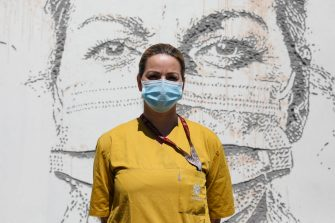 epa08495731 Health worker Carla Queiros poses in front of her portrait that is part of a mural at Sao Joao Hospital in Porto, Portugal, 19 June 2020. The artwork carved by Portuguese street artist Alexandre Farto, tag-named as VHILS, depicts the faces of ten healthcare workers and is a tribute to all medical and health workers who are looking after those in need amid the ongoing pandemic of the COVID-19 disease caused by the SARS-CoV-2 coronavirus.  EPA/JOSE COELHO