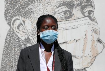 epa08495713 Health worker Cristina Teixeira poses in front of her portrait that is part of a mural at Sao Joao Hospital in Porto, Portugal, 19 June 2020. The artwork carved by Portuguese street artist Alexandre Farto, tag-named as VHILS, depicts the faces of ten healthcare workers and is a tribute to all medical and health workers who are looking after those in need amid the ongoing pandemic of the COVID-19 disease caused by the SARS-CoV-2 coronavirus.  EPA/JOSE COELHO