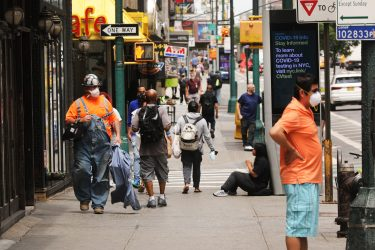 NEW YORK, NEW YORK - JUNE 18: People walk through Manhattan  as the city prepares to enter stage 2 of reopening this coming Monday on June 18, 2020 in New York City. As the economic setbacks from the coronavirus pandemic continue, the Department of Labor said Thursday that another 1.5 million workers filed for first-time jobless benefits last week, a decline of only 58,000 from the week before. (Photo by Spencer Platt/Getty Images)