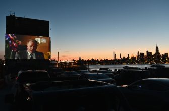 People watch a movie at the Skyline Drive-In NYC cinema experience on June 16, 2020 in the Brooklyn Borough of New York City, amid the novel coronavirus pandemic. (Photo by Angela Weiss / AFP) (Photo by ANGELA WEISS/AFP via Getty Images)
