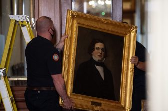 "Architect of the Capitol maintenance workers remove a painting of former confederate House Speaker Howell Cobb of Georgia, from the east staircase of the Speakers lobby, on Capitol Hill on June 18, 2020. - House Speaker Nancy Pelosi on June 18 ordered the removal from the US Capitol of four portraits of former lawmakers who served in the Confederacy, saying their images symbolize ""grotesque racism.""  The four outgoing portraits depict 19th century speakers of the House who also served in the Confederacy: Robert Hunter of Virginia, Howell Cobb of Georgia, James Orr of South Carolina, and Charles Crisp of Georgia. (Photo by Nicholas Kamm / POOL / AFP) (Photo by NICHOLAS KAMM/POOL/AFP via Getty Images)"