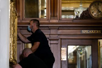 "Architect of the Capitol maintenance workers remove a painting of former confederate speaker James Orr of South Carolina, from the east staircase of the Speakers lobby, on Capitol Hill on June 18, 2020. - House Speaker Nancy Pelosi on June 18 ordered the removal from the US Capitol of four portraits of former lawmakers who served in the Confederacy, saying their images symbolize ""grotesque racism.""  The four outgoing portraits depict 19th century speakers of the House who also served in the Confederacy: Robert Hunter of Virginia, Howell Cobb of Georgia, James Orr of South Carolina, and Charles Crisp of Georgia. (Photo by Graeme Jennings / POOL / AFP) (Photo by GRAEME JENNINGS/POOL/AFP via Getty Images)"