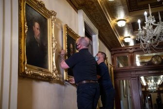 "Architect of the Capitol maintenance workers remove a painting of former confederate speaker James Orr of South Carolina, from the east staircase of the Speakers lobby, on Capitol Hill on June 18, 2020. - House Speaker Nancy Pelosi on June 18 ordered the removal from the US Capitol of four portraits of former lawmakers who served in the Confederacy, saying their images symbolize ""grotesque racism.""  The four outgoing portraits depict 19th century speakers of the House who also served in the Confederacy: Robert Hunter of Virginia, Howell Cobb of Georgia, James Orr of South Carolina, and Charles Crisp of Georgia. (Photo by Nicholas Kamm / POOL / AFP) (Photo by NICHOLAS KAMM/POOL/AFP via Getty Images)"