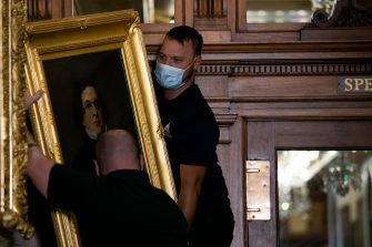 WASHINGTON, DC - JUNE 18: Architect of the Capitol maintenance workers remove a painting of Howell Cobb of Georgia, from the east staircase of the Speakers lobby, on Capitol Hill, on June 18, 2020 in Washington, DC. The portraits of Robert Hunter, James Orr, Howell Cobb and Charles Crisp were removed on the orders of Speaker Nancy Pelosi (D-CA) ahead of the Juneteenth holiday and in the wake of nationwide protests against police brutality and systemic racism. (Photo by Graeme Jennings-Pool/Getty Images)