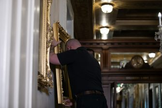 WASHINGTON, DC - JUNE 18: Architect of the Capitol maintenance workers remove a painting of  former speaker James Orr of South Carolina, from the east staircase of the Speakers lobby, on Capitol Hill, on June 18, 2020 in Washington, DC. The portraits of Robert Hunter, James Orr, Howell Cobb and Charles Crisp were removed on the orders of Speaker Nancy Pelosi (D-CA) ahead of the Juneteenth holiday and in the wake of nationwide protests against police brutality and systemic racism. (Photo by Graeme Jennings-Pool/Getty Images)