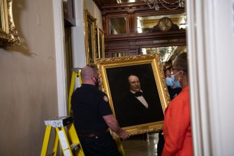 WASHINGTON, DC - JUNE 18: Architect of the Capitol workers remove the portrait of Confederate speaker James Orr from a wall in the Speaker's Lobby of the U.S. Capitol on June 18, 2020 in Washington, DC. The portraits of Robert Hunter, James Orr, Howell Cobb and Charles Crisp were removed on the orders of Speaker Nancy Pelosi (D-CA) ahead of the Juneteenth holiday and in the wake of nationwide protests against police brutality and systemic racism. (Photo by Nicholas Kamm-Pool/Getty Images)
