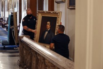 WASHINGTON, DC - JUNE 18: Staff from the Architect of the Capitol remove a portrait of former Speaker of the House Robert Hunter of Virginia (1839-1841), who was a Confederate official, from the Speaker's Lobby in the U.S. Capitol June 18, 2020 in Washington, DC. The portraits of Hunter, James Orr, Howell Cobb and Charles Crisp were removed on the orders of Speaker Nancy Pelosi (D-CA) ahead of the Juneteenth holiday and in the wake of nationwide protests against police brutality and systemic racism. (Photo by Chip Somodevilla/Getty Images)