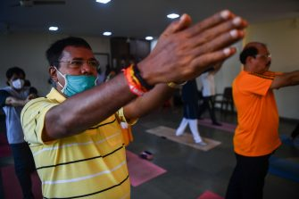 Men attend a yoga class during International Yoga Day, in Mumbai on June 21, 2020. (Photo by INDRANIL MUKHERJEE / AFP) (Photo by INDRANIL MUKHERJEE/AFP via Getty Images)
