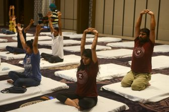 People attend a yoga class at a hotel during International Yoga Day, in Siliguri on June 21, 2020. (Photo by Diptendu DUTTA / AFP) (Photo by DIPTENDU DUTTA/AFP via Getty Images)