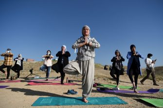 Fakhria Momtaz,43,(C)trainer and founder of Kabul's first yoga center for Woman,take part in a yoga session during International Yoga Day,at the Shahrak Haji Nabi hilltop on the outskirts of Kabul on June 21,2020. (Photo by WAKIL KOHSAR / AFP) (Photo by WAKIL KOHSAR/AFP via Getty Images)