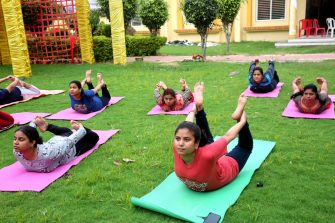 epa08499682 Indian women performing yoga on World Yoga Day, in Bhopal, India, 21 June 2020. The United Nations proclaimed 21 June as the International Day of Yoga, by its resolution 69/131 on 11 December 2014.  EPA/SANJEEV GUPTA