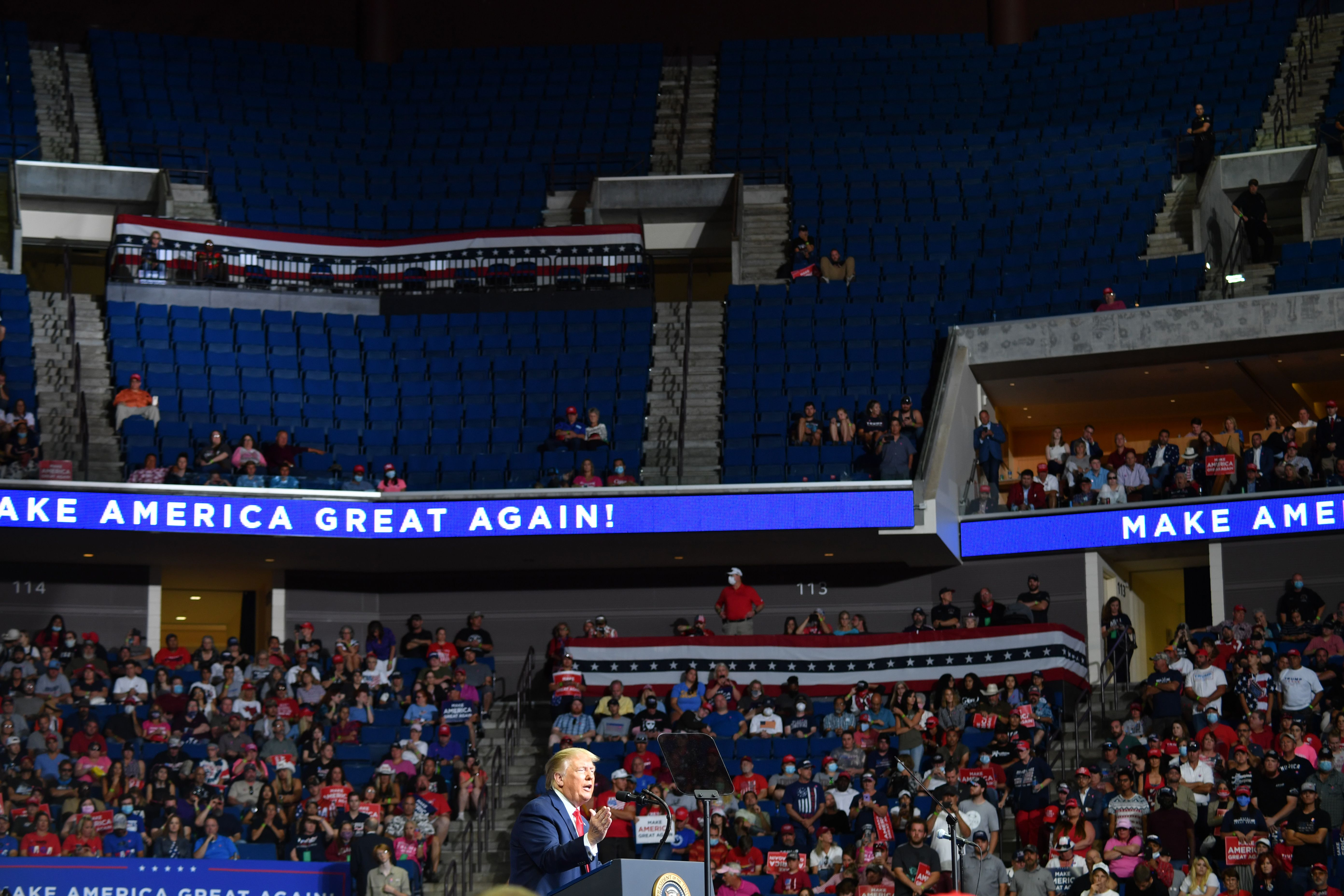 The upper section of the arena is seen partially empty as US President Donald Trump speaks during a campaign rally at the BOK Center on June 20, 2020 in Tulsa, Oklahoma. - Hundreds of supporters lined up early for Donald Trump's first political rally in months, saying the risk of contracting COVID-19 in a big, packed arena would not keep them from hearing the president's campaign message. (Photo by Nicholas Kamm / AFP) (Photo by NICHOLAS KAMM/AFP via Getty Images)