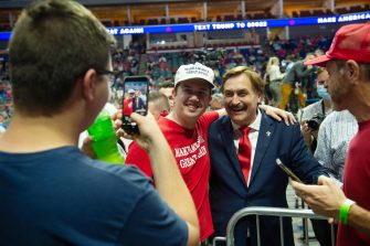 epa08499464 My Pillow CEO Michael J. Lindell (C-R) poses with Supporters of US President Donald J. Trump during a rally inside the Bank of Oklahoma Center in Tulsa, Oklahoma, USA, 20 June 2020. The campaign rally is the first since the COVID-19 pandemic locked most of the country down in March 2020.  EPA/ALBERT HALIM