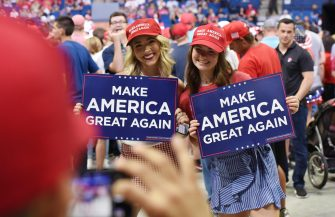 epa08499459 Supporters of US President Donald J. Trump hold placards during a rally inside the Bank of Oklahoma Center in Tulsa, Oklahoma, USA, 20 June 2020. The campaign rally is the first since the COVID-19 pandemic locked most of the country down in March 2020.  EPA/ALBERT HALIM