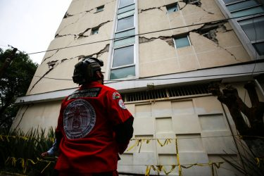 MEXICO CITY, MEXICO - JUNE 23: An urban search and rescue rescuer looks a damage bulding since the 2017 earthquake on June 23, 2020 in Mexico City, Mexico. According to the National Seismological Service a 7.5 magnitude earthquake was registered on Tuesday in Mexico City and in various areas of the country. (Photo by Manuel Velasquez/Getty Images)