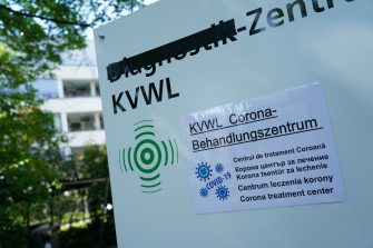 GUETERSLOH, GERMANY - JUNE 23: A sign indicated the location of a new treatment facility for Covid-19 cases at the city hospital following an outbreak among workers at the nearby Toennies meat packing plant during the coronavirus pandemic on June 23, 2020 in Guetersloh, Germany. State authorities announced today they are placing the entire Guetersloh region into semi-lockdown following confirmed Covid-19 infections among over 1,500 employees of the plant. The Bundeswehr, the German armed forces, has stepped in to help test people at the approximately 250 houses and apartment complexes where Toennies employees, many of whom come from Romania, Bulgaria and Poland, live throughout the Guetersloh region. (Photo by Sean Gallup/Getty Images)