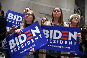 Supporters of Democratic presidential hopeful former Vice President Joe Biden cheers as he speaks, flanked by his wife Jill Biden, at the National Constitution Center in Philadelphia, Pennsylvania on March 10, 2020. (Photo by Mandel NGAN / AFP) (Photo by MANDEL NGAN/AFP via Getty Images)