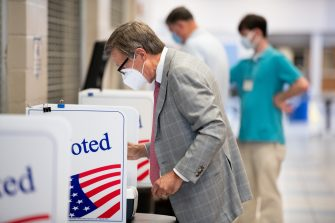 COLUMBIA, SC - JUNE 09: Voters cast ballots at a polling station at Dreher High School on June 9, 2020 in Columbia, South Carolina. Georgia, Nevada, North Dakota, South Carolina and West Virginia hold primaries today.  (Photo by Sean Rayford/Getty Images)