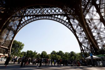 Visitors queue as they wait for the partial reopening of Eiffel Tower on June 25, 2020, in Paris, as France eases lockdown measures taken to curb the spread of the COVID-19 caused by the novel coronavirus. - Tourists and Parisians will again be able to admire the view of the French capital from the Eiffel Tower after a three-month closure due to the coronavirus -- but only if they take the stairs. (Photo by Thomas SAMSON / AFP) (Photo by THOMAS SAMSON/AFP via Getty Images)