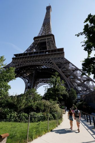 People arrive for the partial reopening of Eiffel Tower on June 25, 2020, in Paris, as France eases lockdown measures taken to curb the spread of the COVID-19 caused by the novel coronavirus. - Tourists and Parisians will again be able to admire the view of the French capital from the Eiffel Tower after a three-month closure due to the coronavirus -- but only if they take the stairs. (Photo by Thomas SAMSON / AFP) (Photo by THOMAS SAMSON/AFP via Getty Images)