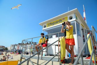 WEYMOUTH, ENGLAND - JUNE 24: Lifeguards keep watch over visitors as they enjoy the hot weather on the beach on June 24, 2020 in Weymouth, United Kingdom. The UK is experiencing a summer heatwave, with temperatures in many parts of the country expected to rise above 30C and weather warnings in place for thunderstorms at the end of the week. (Photo by Finnbarr Webster/Getty Images)