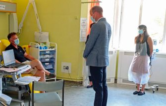 Britain's Prince William, Duke of Cambridge, wearing PPE (personal protective equipment), of a face mask or covering as a precautionary measure against spreading COVID-19, talks to a patient participating in a COVID-19 vaccine trial at Oxford Vaccine Group's facility at Churchill Hospital in Oxford, west of London on June 24, 2020, during a visit to learn more about their work to establish a viable vaccine against coronavirus. (Photo by Steve Parsons / POOL / AFP) (Photo by STEVE PARSONS/POOL/AFP via Getty Images)