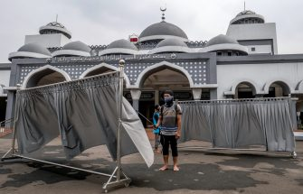 "Employees at the Hajj dormitory clean and spray disinfectants to the facilities normally used for praticing pilgrimage, in Jakarta on June 23, 2020, which has not been used since last March amid COVID-19 coronavirus pandemic and as the government of Saudi Arabia stopped organizing the pilgrimage. - Saudi Arabia has announced it will hold a ""very limited"" hajj this year, with pilgrims already in the kingdom allowed to perform the annual ritual as it moves to curb the biggest coronavirus outbreak in the Gulf. (Photo by BAY ISMOYO / AFP) (Photo by BAY ISMOYO/AFP via Getty Images)"