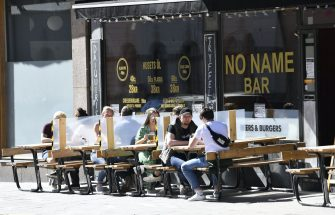 People enjoy the sunny weather at an outdoor restaurant in Stockholm on May 30, 2020, amid the novel coronavirus pandemic. (Photo by Henrik MONTGOMERY / TT News Agency / AFP) / Sweden OUT (Photo by HENRIK MONTGOMERY/TT News Agency/AFP via Getty Images)