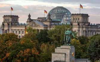 BERLIN, GERMANY - OCTOBER 03: A view of the Bundestag (German parliament) and its glass dome, with the monument to the soviet soldier in the foreground on German Unity Day (Tag der Deutschen Einheit) on October 3, 2017 in Berlin, Germany. Unity Day commemorates the reunification of East and West Germany following the end of the Cold War in 1991. This year Germany is looking somewhat less unified after the right-wing Alternative for Germany (AfD) political party won 12.6% of the vote in federal elections in September, with the strongest turnout occurring in parts of eastern and southern Germany. (Photo by Omer Messinger/Getty Images)