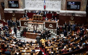 French members of Parliament leaves the National Assembly hemicycle after a vote to ratify the CETA during a session at the French National Assembly in Paris on July 23, 2019 as screens indicated the result of the vote which has been voted by 266 votes for and 213 against the bill. - The Comprehensive Economic and Trade Agreement (CETA) went into effect in practically its entirety in September 2017 and so far has been ratified by 13 of the 28 European Union member states and Canada. The pact removes tariffs on nearly all goods and services between Canada and Europe, which the EU says eliminates 590 million euros ($890 million Canadian/$665 million) in customs duties each year. (Photo by STEPHANE DE SAKUTIN / AFP)        (Photo credit should read STEPHANE DE SAKUTIN/AFP via Getty Images)