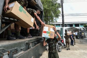 Members of the Brazilian Armed Forces unload medical supplies at a military hospital in Tabatinga, Amazonas state, Brazil, on June 19, 2020, amid the new coronavirus pandemic. - As the new coronavirus has ravaged Brazil, more than 7,000 indigenous people have contracted the virus, and more than 300 have died, according to the Brazilian Indigenous Peoples' Association (APIB), forcing many indigenous groups to take matters into their own hands. Some have locked the world out, banning outsiders and putting up a makeshift roadblock at the entrance to their territory, while others have fled into the jungle. (Photo by EVARISTO SA / AFP) (Photo by EVARISTO SA/AFP via Getty Images)