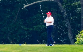 epa08512911 US President Donald J. Trump plays golf at the Trump National Golf Club in Sterling, Virginia, USA, 27 June 2020. On 26 June, Trump abruptly canceled a weekend trip to Bedminster, NJ, tweeting that he 'wanted to stay in Washington, D.C. to make sure LAW & ORDER is enforced.'  EPA/JIM LO SCALZO