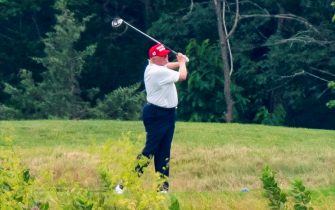 epa08512908 US President Donald J. Trump plays golf at the Trump National Golf Club in Sterling, Virginia, USA, 27 June 2020. On 26 June, Trump abruptly canceled a weekend trip to Bedminster, NJ, tweeting that he 'wanted to stay in Washington, D.C. to make sure LAW & ORDER is enforced.'  EPA/JIM LO SCALZO