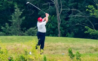epa08512907 US President Donald J. Trump plays golf at the Trump National Golf Club in Sterling, Virginia, USA, 27 June 2020. On 26 June, Trump abruptly canceled a weekend trip to Bedminster, NJ, tweeting that he 'wanted to stay in Washington, D.C. to make sure LAW & ORDER is enforced.'  EPA/JIM LO SCALZO