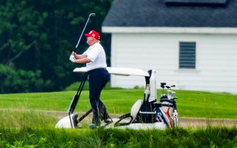 epa08512914 US President Donald J. Trump plays golf at the Trump National Golf Club in Sterling, Virginia, USA, 27 June 2020. On 26 June, Trump abruptly canceled a weekend trip to Bedminster, NJ, tweeting that he 'wanted to stay in Washington, D.C. to make sure LAW & ORDER is enforced.'  EPA/JIM LO SCALZO