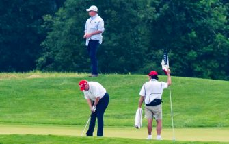 epa08512913 US President Donald J. Trump (bottom left) plays golf at the Trump National Golf Club in Sterling, Virginia, USA, 27 June 2020. On 26 June, Trump abruptly canceled a weekend trip to Bedminster, NJ, tweeting that he 'wanted to stay in Washington, D.C. to make sure LAW & ORDER is enforced.'  EPA/JIM LO SCALZO