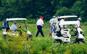 epa08512906 US President Donald J. Trump (C) plays golf at the Trump National Golf Club in Sterling, Virginia, USA, 27 June 2020. On 26 June, Trump abruptly canceled a weekend trip to Bedminster, NJ, tweeting that he 'wanted to stay in Washington, D.C. to make sure LAW & ORDER is enforced.'  EPA/JIM LO SCALZO
