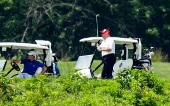 epa08512921 US President Donald J. Trump plays golf at the Trump National Golf Club in Sterling, Virginia, USA, 27 June 2020. On 26 June, Trump abruptly canceled a weekend trip to Bedminster, NJ, tweeting that he 'wanted to stay in Washington, D.C. to make sure LAW & ORDER is enforced.'  EPA/JIM LO SCALZO
